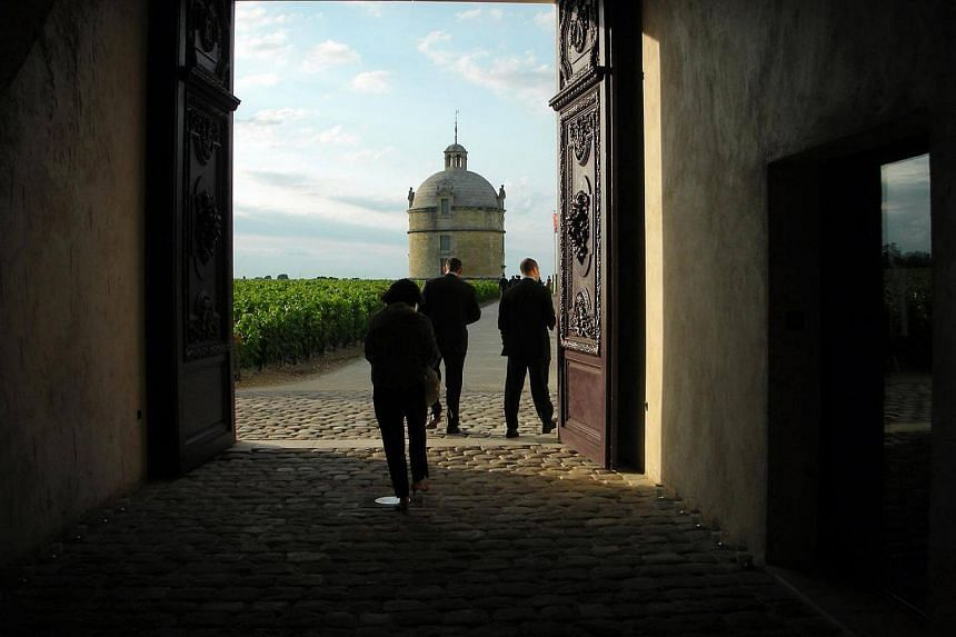 The famous tower of chateau Latour in France, framed in the arch of the cellar passage, taken in June 2007.