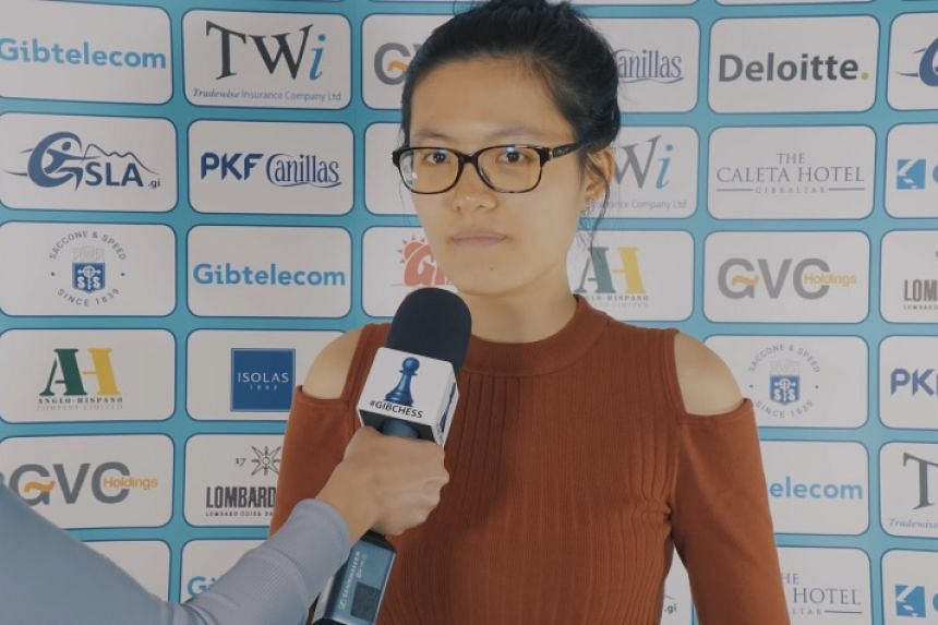 Hou Yifan apologises to fans for throwing the game during a post-match interview.