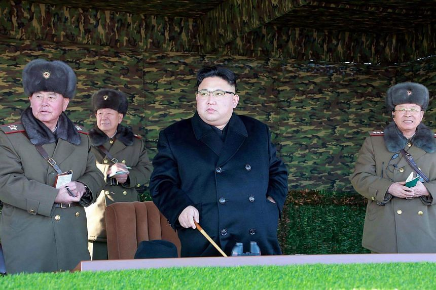 North Korean leader Kim Jong Un guides the winter river-crossing attack tactical drill of the reinforced tank and armored infantry regiment in Pyongyang.