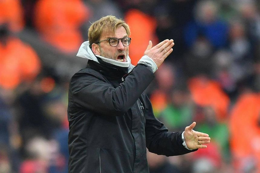 Jurgen Klopp gestures on the touchline during the English Premier League football match between Liverpool and Swansea City.