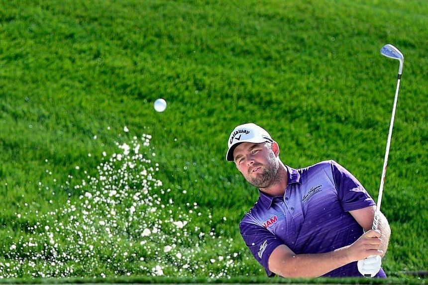 Marc Leishman of Australia plays his third shot from the sand on the fifth hole during the first round of the Waste Management Phoenix Open at TPC Scottsdale on Feb 2, 2017.