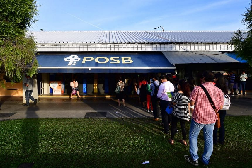 People queueing up to deposit money around 8am outside POSB at Tampines Central on Feb 03, 2017.