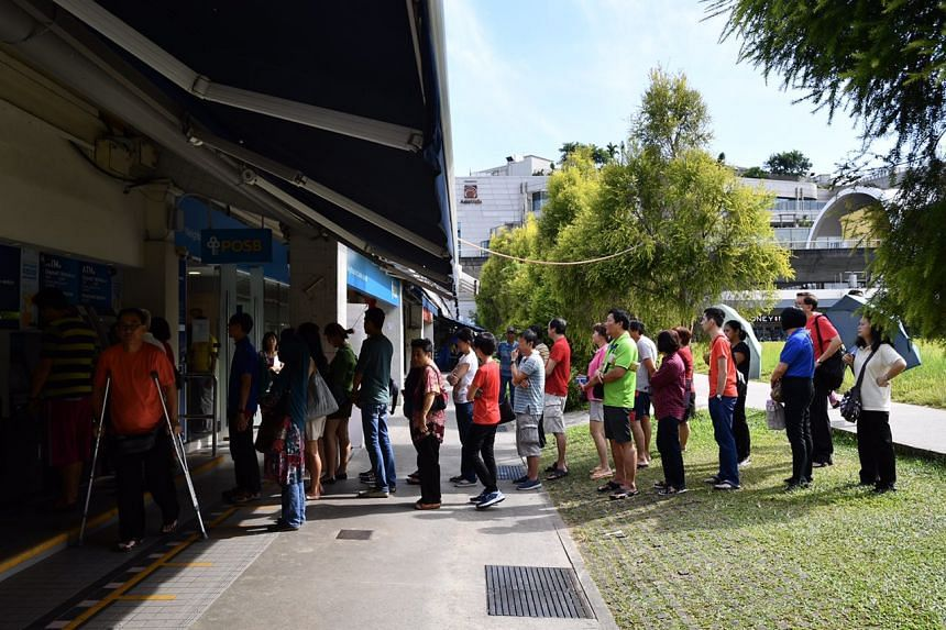 People queueing up to deposit money around 10.10am outside POSB at Tampines Central on Feb 03, 2017.
