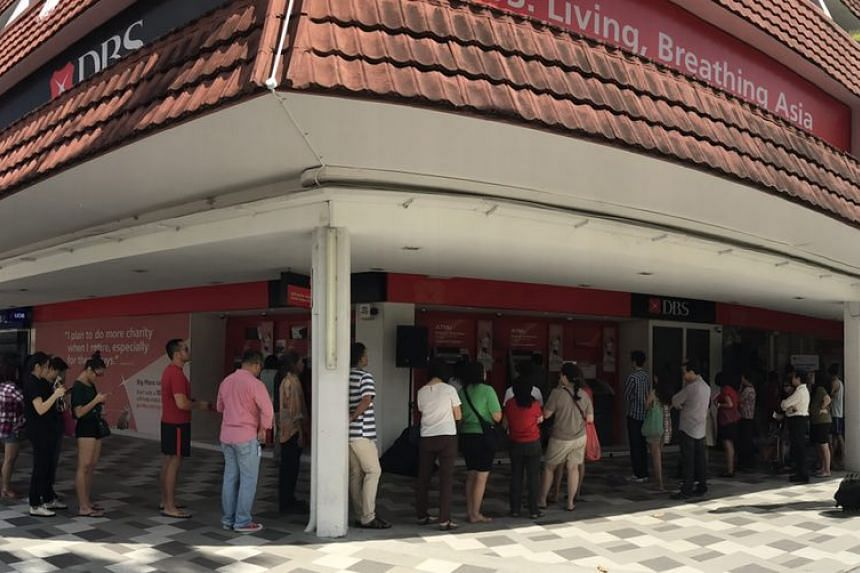 People queueing up to deposit money at DBS Bedok branch at Blk 210 New Upper Changi Road on Feb 03, 2017.