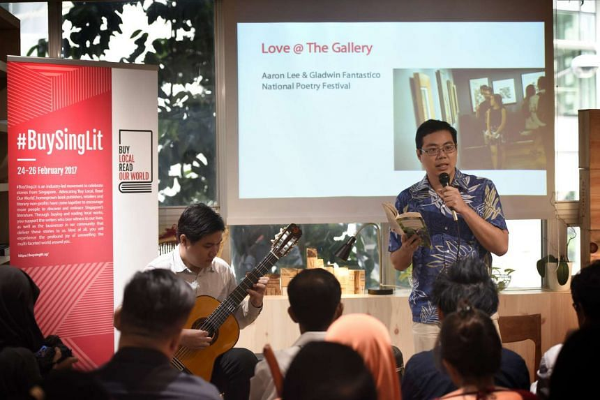 Poet Aaron Lee (above, right) performing at the launch of the #BuySingLit campaign, accompanied by guitarist Gladwin Pantastico.