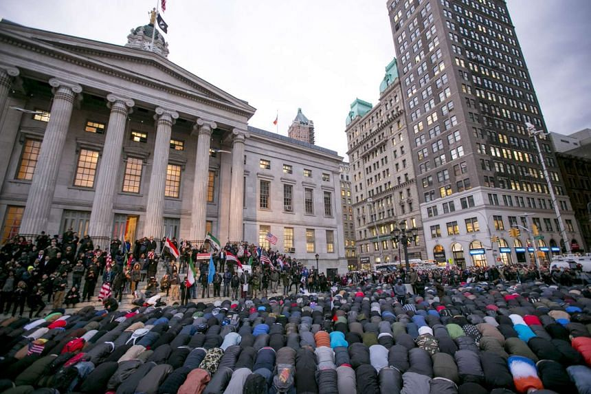 Muslims, including many proprietors of Yemeni-owned businesses, pray outside Brooklyn Borough Hall during a protest of President Donald Trump's executive order barring immigration from 7 Muslim-majority countries.
