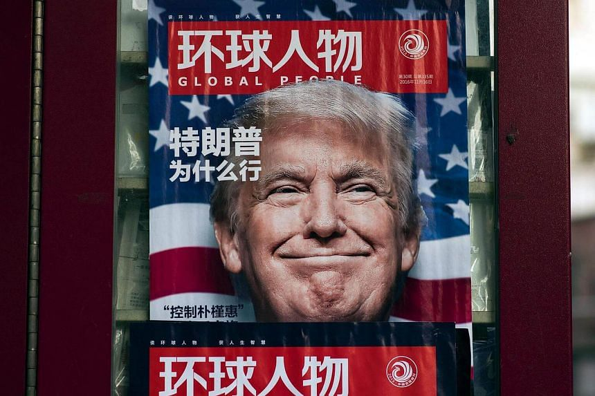 An advertisement for a magazine featuring US President Donald Trump on the cover at a news stand in Shanghai. China.