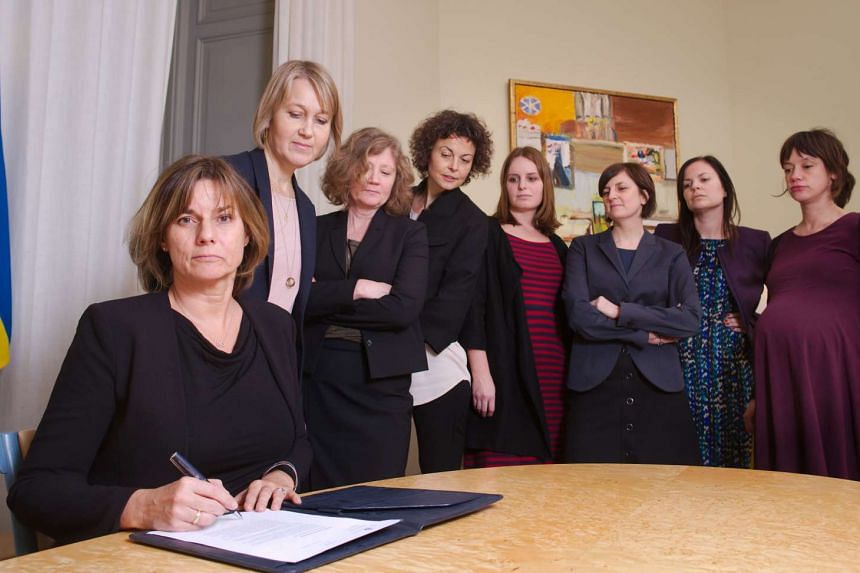 Swedish Environment Minister and Deputy Prime Minister Isabella Lovin (left) signing a referral of Swedish climate law, binding all future governments to net zero emissions by 2045 at the ministry in Stockholm, on Feb 1, 2017.