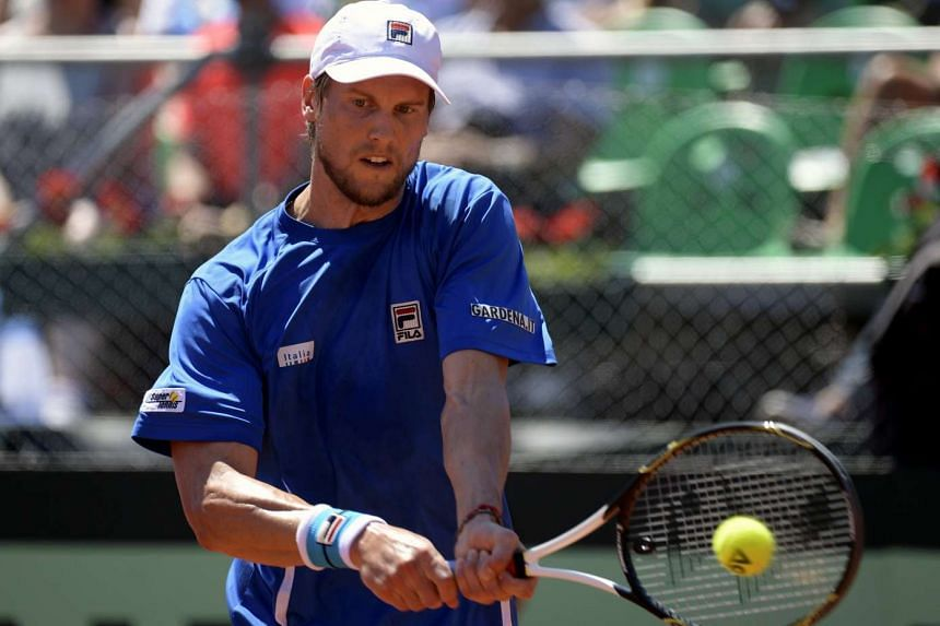 Italy's tennis player Andreas Seppi returns the ball to Argentina's Carlos Berlocq during their 2017 Davis Cup World Group first round single tennis match at Parque Sarmiento stadium in Buenos Aires on Feb 3, 2017.