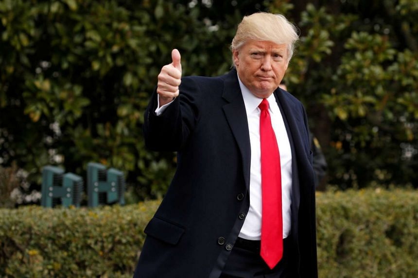US President Donald Trump gives a thumbs up as he departs the White House to spend the weekend in Florida, Feb 3, 2017.