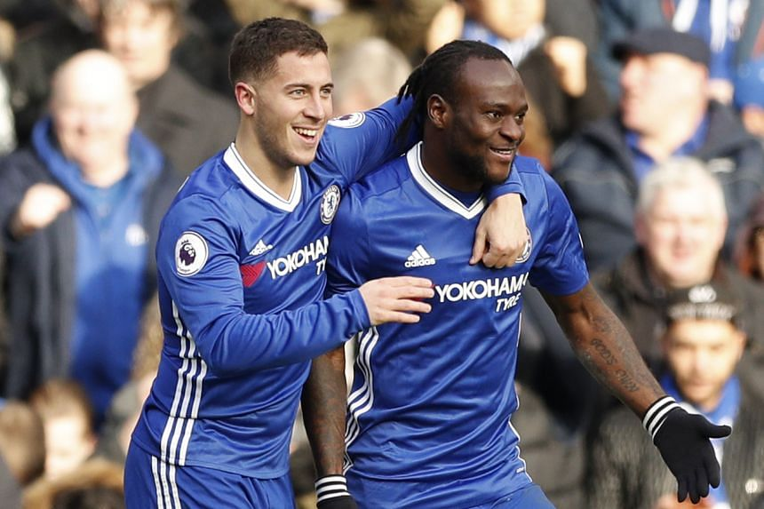 Chelsea's Eden Hazard celebrates scoring their second goal with Victor Moses.