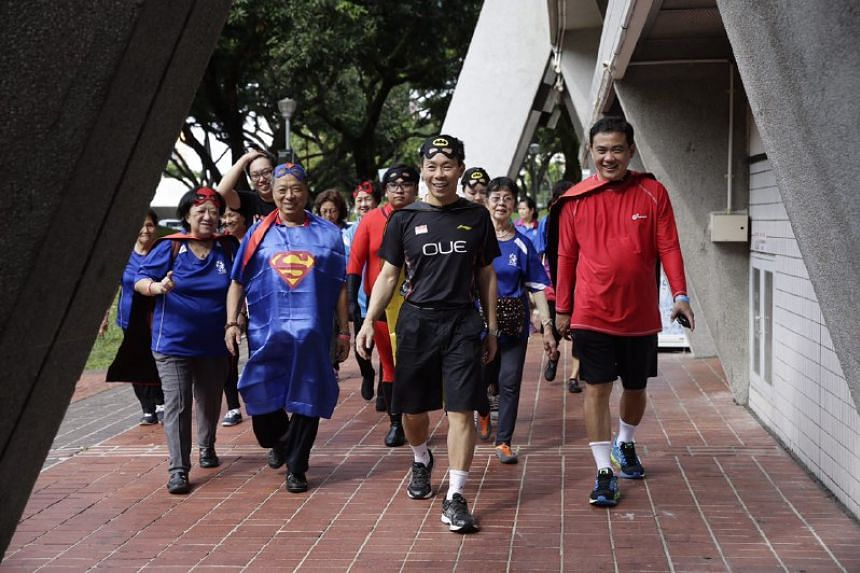 Member of Parliament for East Coast GRC Lee Yi Shyan, donning a superhero cape, joins senior citizens on a walkathon around the sports complex during the ActiveSG/ITE College Central Super Seniors Event at ActiveSG Sports Centre on Saturday (Feb 4).