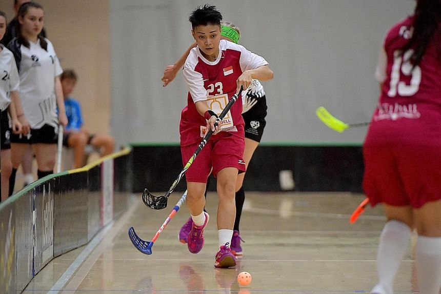 Singapore's player of the match Karen Loo with the ball against New Zealand at the ASB Sports Centre in Wellington yesterday. The Republic beat the hosts 7-1 to seal their spot at the World Championships in Slovakia.