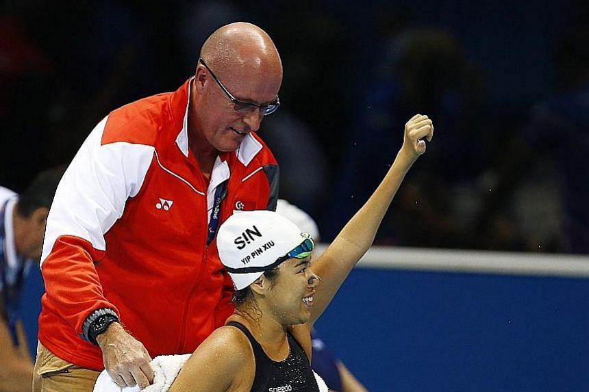 Yip Pin Xiu and coach Mick Massey celebrating in Rio last September after she won the 50m backstroke S2 event to clinch back-to-back golds.