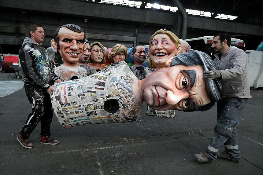 Workers preparing a figure of Mr Fillon for a carnival parade in Nice on Thursday. The former prime minister has denied wrongdoing since graft claims were first reported last week.