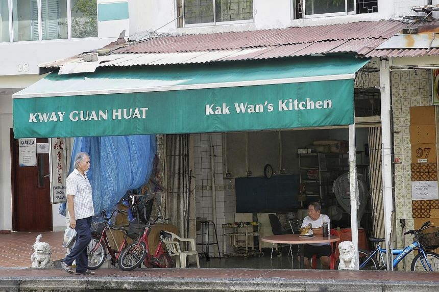 Mr Quek (top), co-owner of Kway Guan Huat Joo Chiat Popiah & Kueh Pie Tie (above), making popiah skin in his younger days.