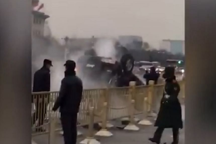 Screengrab of the overturned car near Tiananmen Square.