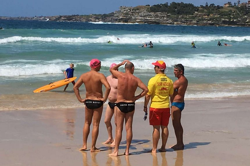 The children's doctor is a volunteer patrol supervisor (left, in yellow top) for the North Bondi Surf Life Saving Club.