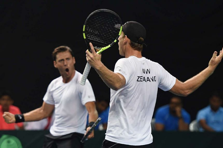 New Zealand's Artem Sitak and Michael Venus (right) celebrate after winning the Davis Cup doubles.
