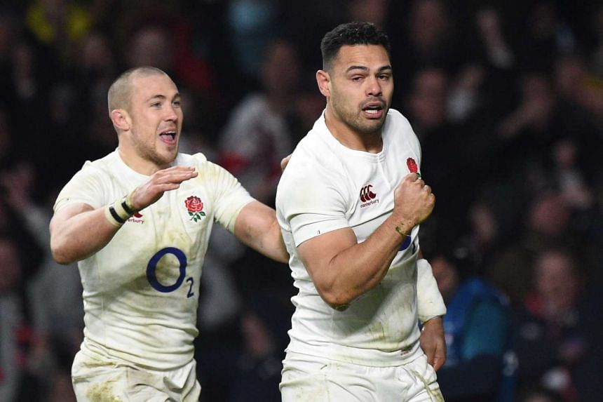 England's Ben Teo (right) celebrates with team mate Mike Brown after scoring a try.