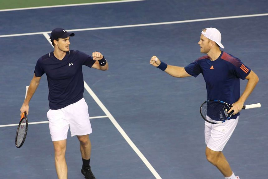 Jamie Murray and Dominic Inglot Great Britain win a point against Daniel Nestor and Vasek Pospisil of Canada.