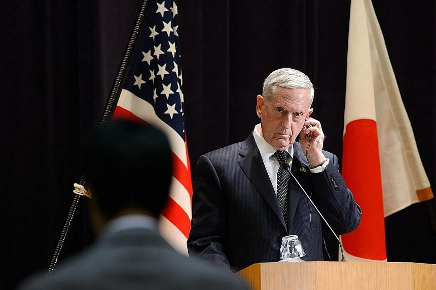 Mr Mattis in Tokyo yesterday, on a trip which also took in Seoul. The US defence chief made clear that Washington was ready to answer any threats its allies in the region may face.