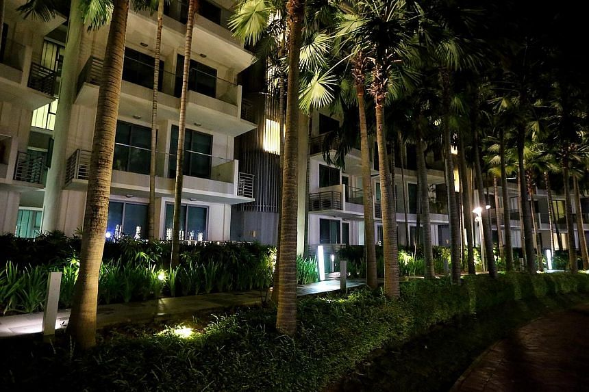 Many units at The Residences at W in Sentosa Cove (above) were unlit when The Sunday Times visited at 9.30pm on Thursday. In the Core Central Region (CCR), which includes Sentosa, the private home vacancy rate at the fourth quarter last year was 9.6