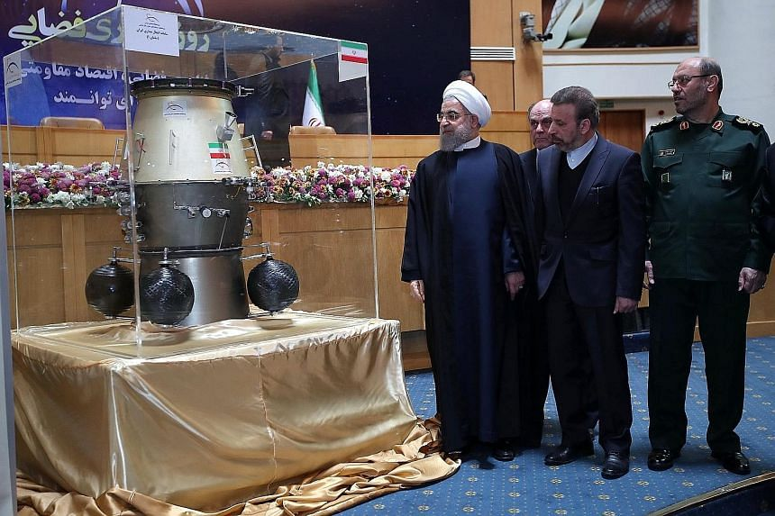 Iranian President Hassan Rouhani at an exhibition showcasing his country's space achievements on Wednesday, the same day that Iran confirmed its first ballistic missile test since Mr Trump took office.