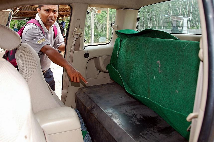 A pick-up (left) with its back seats holding a fuel tank used to smuggle petrol or diesel from Malaysia into Thailand. Malaysian border patrol (right) inspecting a van that had a tank filled with 2,000 litres of fuel to be smuggled into Thailand at B