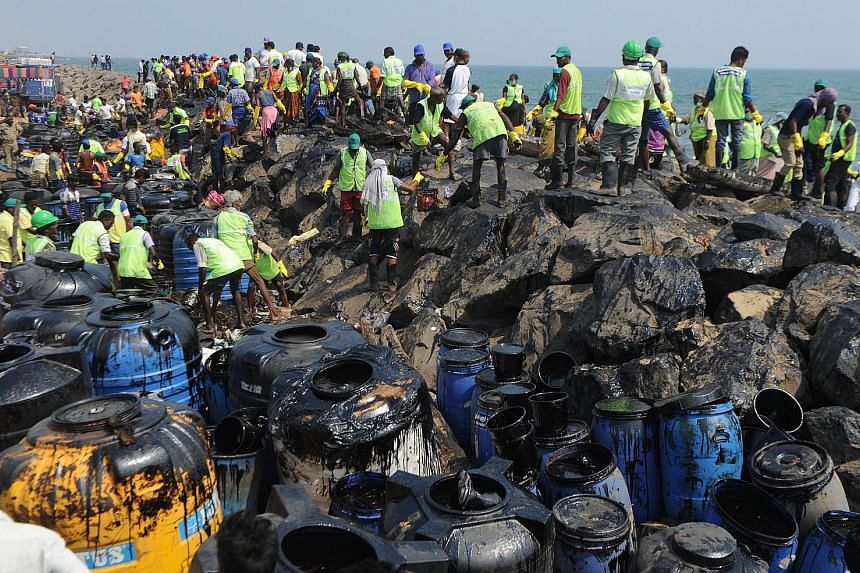 Thousands of volunteers and Coast Guard personnel are working to clean sludge from shores near the Indian city of Chennai, more than a week after an oil spill that activists said could have dire repercussions for wildlife and fishery.