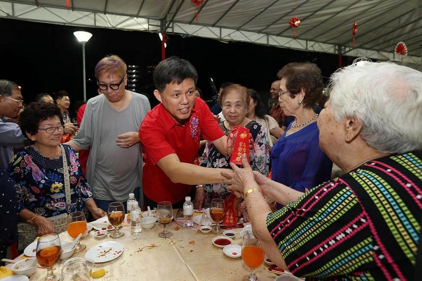 Mr Chan Chun Sing (Minister, Prime Minister's Office and MP for Tanjong Pagar GRC) give out mandarin oranges to residents at the Tanjong Pagar GRC and Radin Mas SMC annual Lunar New Year celebrations dinner at Cambridge Road, on Feb 4, 2017.