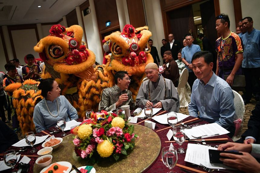 (From left) IMC Organisation founder Juliet Liu, Senior Minister of State for Defence and for Foreign Affairs Maliki Osman, Venerable Master Chin Kung and Education Minister Ong Ye Kung at the Interfaith Chinese New Year Reunion in Furama Riverfront