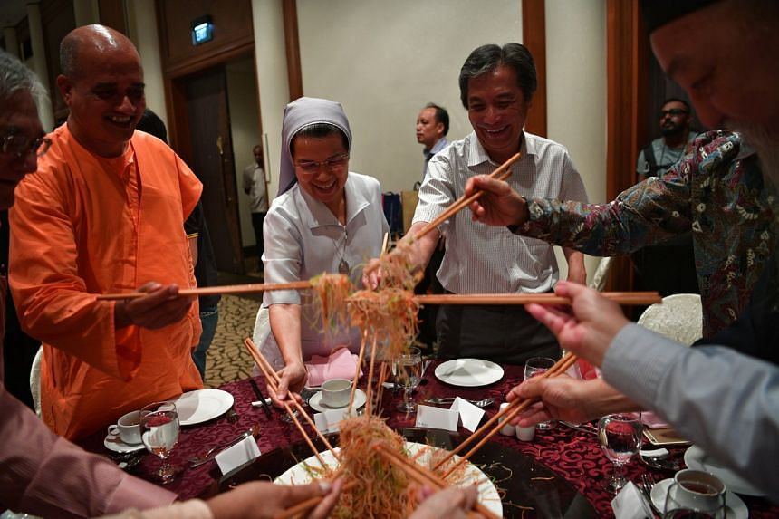 Representatives from the Inter-Religious Organisation Singapore tossing lo hei together at the Interfaith Chinese New Year Reunion held at Furama Riverfront Hotel on Feb 5, 2017.