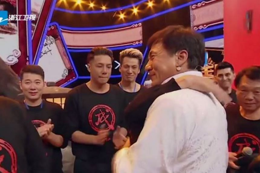 An emotional Jackie Chan embraces a member of this stunt team.