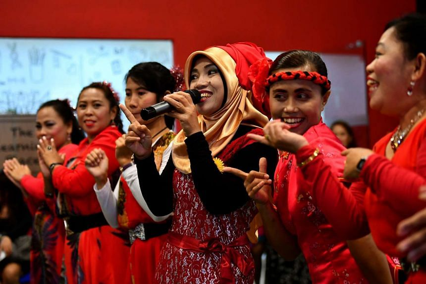 Ms Rokifah Yan Budiati, a foreign domestic worker from Indonesia, singing a Mandarin song during the Chinese New Year celebration at Fast Befriender Club House on Feb 5, 2017.