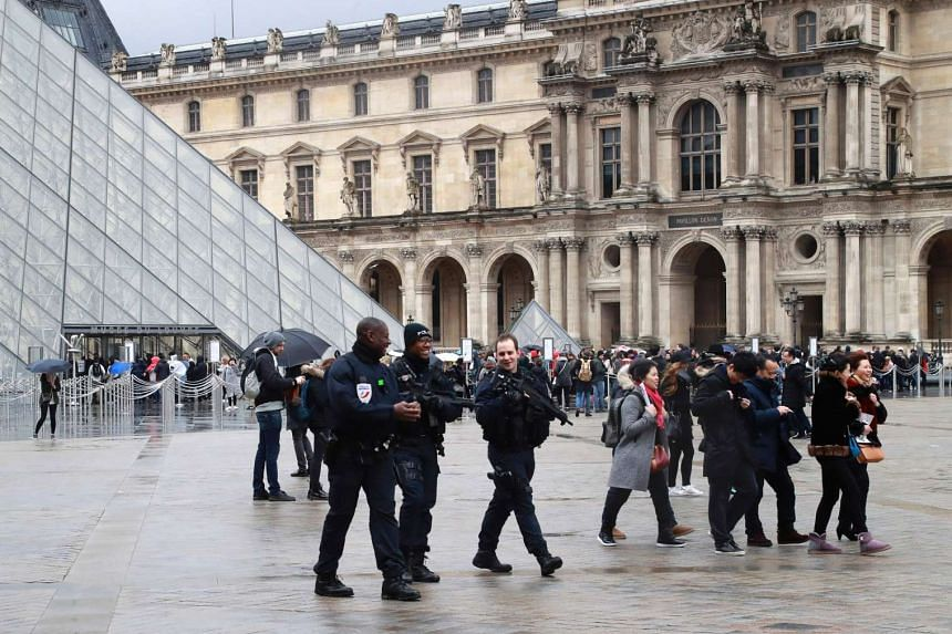 Police officers patrolling in front of the Louvre in Paris on Feb 4, 2017.