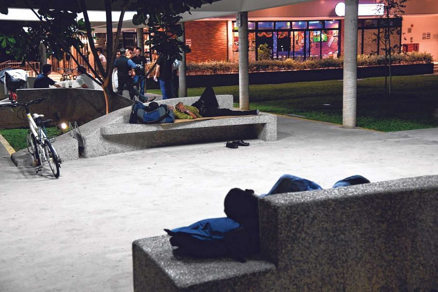 NOW: People sleeping on concrete benches below a sheltered walkway at an East Coast lifestyle hub. Shops and eateries are just a few steps away, providing the convenience and proximity to urban living some of the homeless prefer.