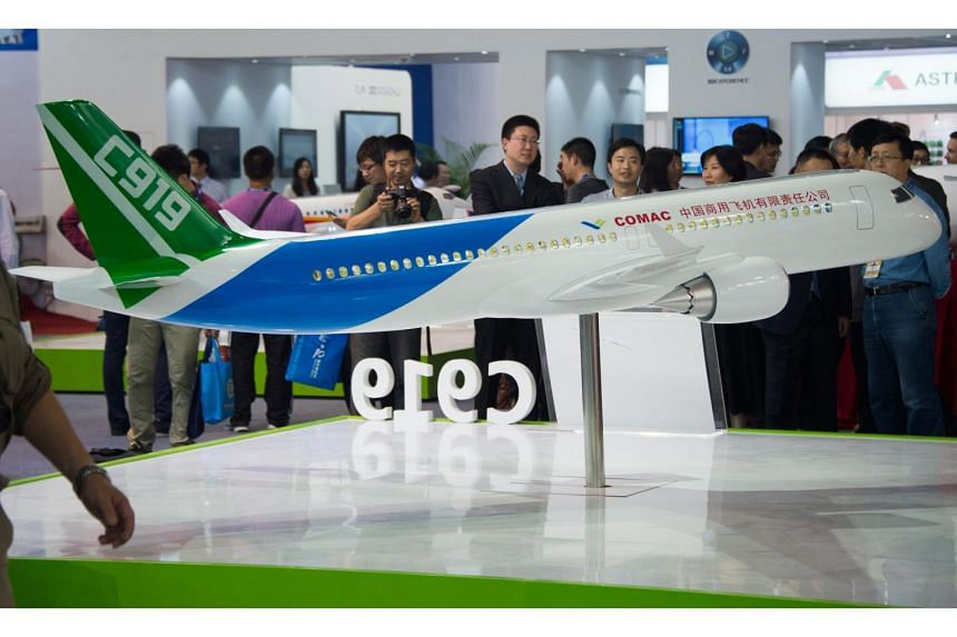 A scale model of the COMAC C919 passenger aircraft on display at the Airshow China 2014 in Zhuhai, southern China's Guangdong province.