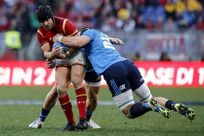 Wales' Leigh Halfpenny (left) is tackled by Italy's Francesco Minto (right) during the RBS Six Nations rugby tournament match between Italy and Wales at Olimpico stadium in Rome, Italy, on Feb 5, 2017.