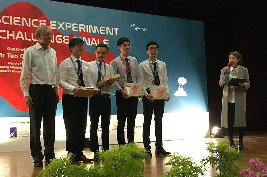 DPM Teo Chee Hean with (from left) students Ngo Wei An, Andre Ang, Noel Sung and Tan Zhen Wen, who were third in their category in the National Science Experiment Big Data Challenge.