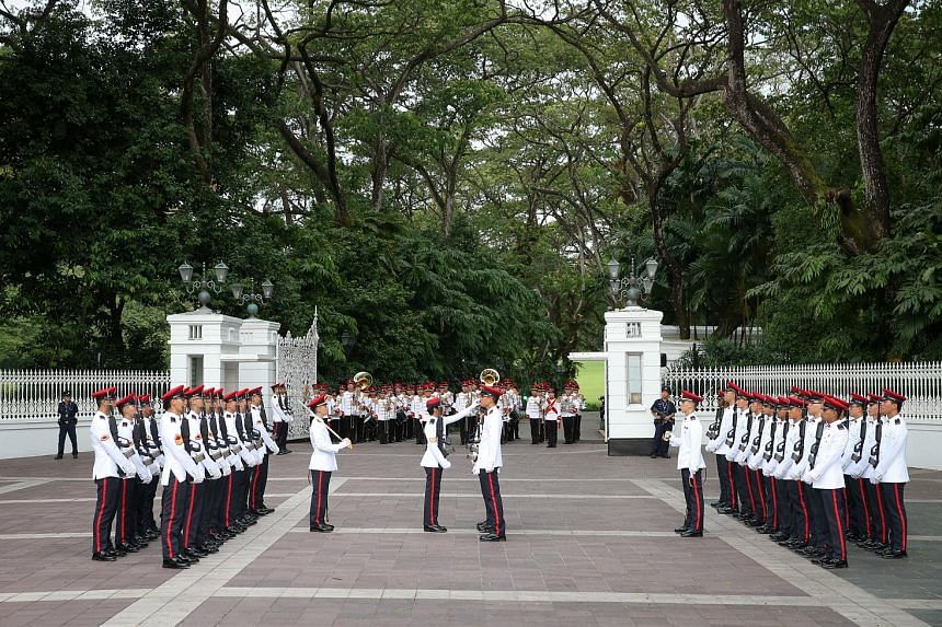 The Singapore Armed Forces (SAF) Military Police Command holding the Changing of Istana Guards Ceremony at the Istana main gate yesterday at 6pm. The occasion saw the new batch of guards marching along Orchard Road to take over from the old batch of