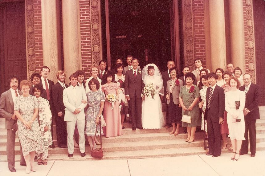 Mr and Mrs Yeo (above) with family and friends outside St Paul Church in Cambridge, Massachusetts, on their wedding day on June 17, 1984. Mrs Yeo (below), a lawyer, has written a book on marriage.