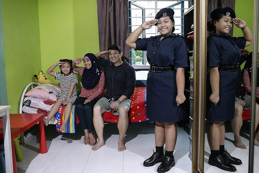 Adawiyah with her younger sister Atiqah; mother, Ms Neny; and father, Mr Shazali. The Punggol Secondary School student was inspired to join NPCC by her parents, who were both part of uniformed groups when they were in school.