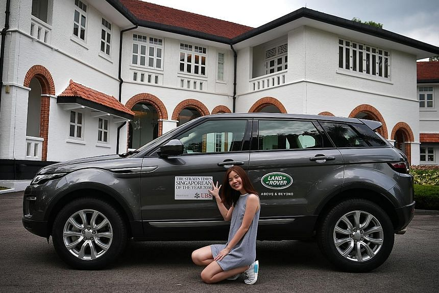 SPH Editorial Projects Unit brand manager Priscilla Tan with the Range Rover Evoque at UBS Business University Asia Pacific. Finalists of The Straits Times Singaporean of the Year 2016 will arrive in style for the award ceremony in Land Rovers and Ja