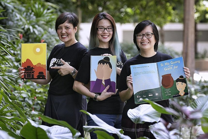 Si Ma Guang And The Giant Jar's author, Ms Lee (far right), with illustrator, Ms Tan (centre), and Helang Books founder, Ms Hidayah. The book has Braille dots for the blind, and text in a font designed for readers with dyslexia.