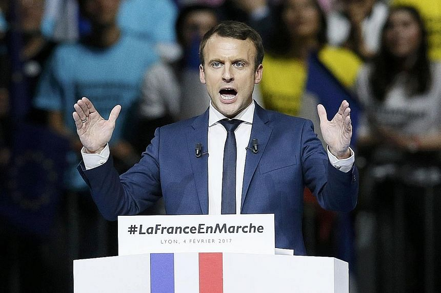 Mr Macron at a campaign rally in Lyon last Saturday. Polls now show the former investment banker would reach the election run-off on May 7.