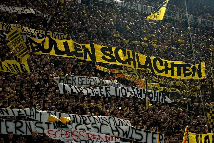 Supporters of Dortmund displaying banners prior to the German First division Bundesliga football match between Borussia Dortmund and RB Leipzig, in Dortmund, western Germany on Feb 4, 2017.