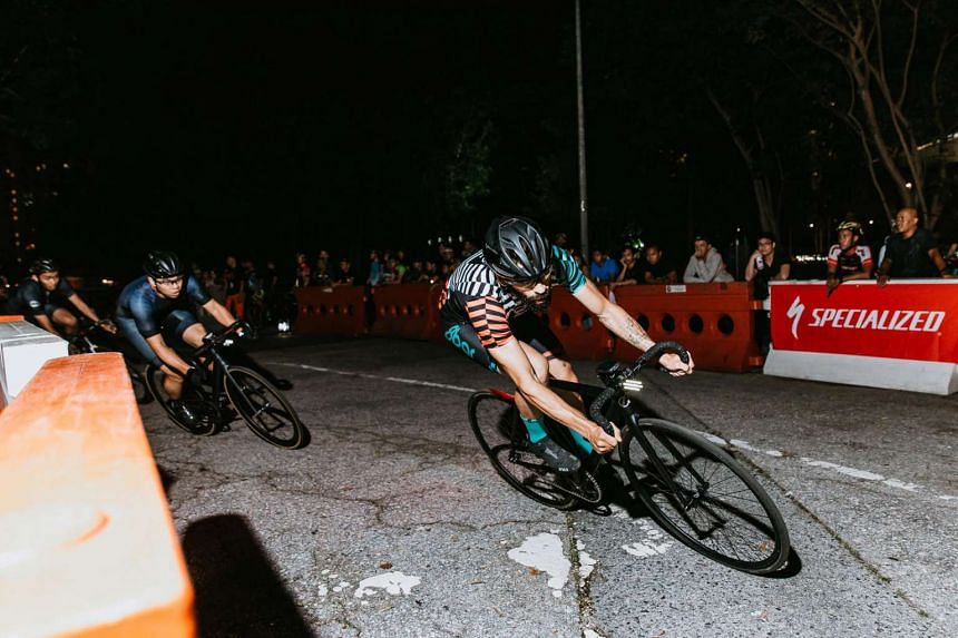 Cyclists race against one another near the Sports Hub on Dec 3, 2016.