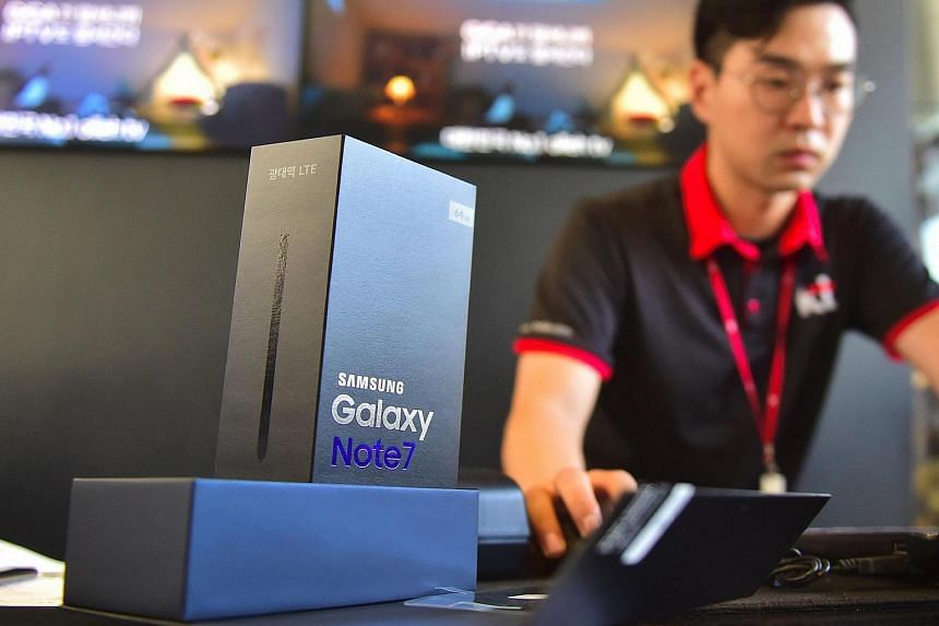An employee working to provide replacement Samsung Galaxy Note7 smartphones at a telecommunications shop in Seoul.