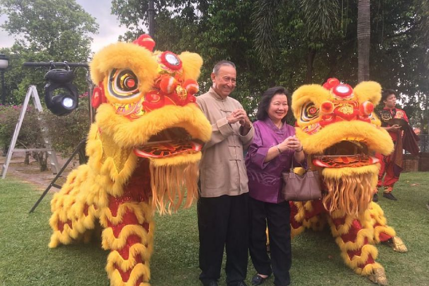 Colin and May Schooling posing with a lion dance troupe at the UBS Business University on Feb 6, 2017.